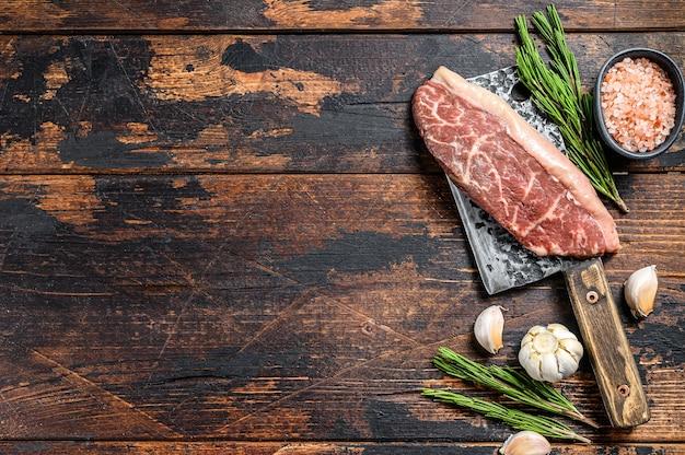 肉切り包丁の生のピカンハまたはトップサーロインキャップステーキ