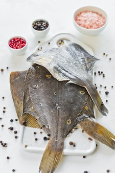 Raw plaice, ingredients for cooking.