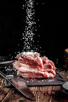 Raw pork meat lies on a cutting board