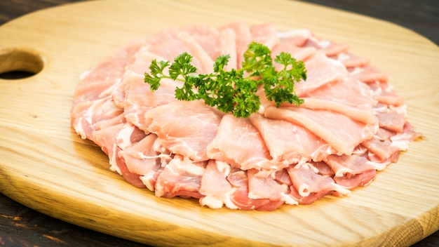 Raw pork meat slice