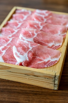 Raw pork meat sukiyaki