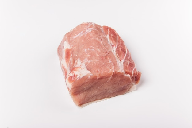 Raw pork meat on white background. whole piece of meat. flat lay, top view