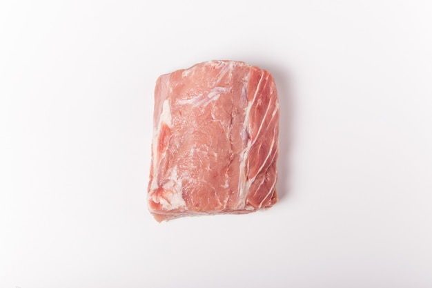 Raw pork meat on  whole piece of meat. flat lay, top view