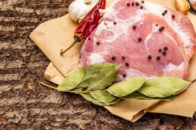 Raw pork shoulder with spices