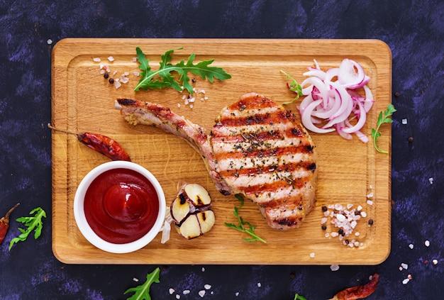 Raw pork steak with herbs
