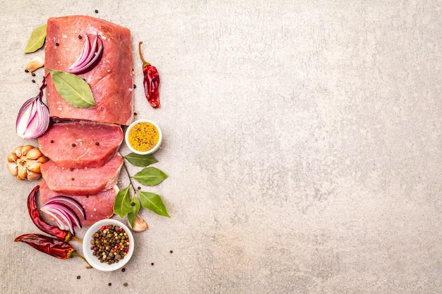 Raw pork tenderloin with vegetables and spices