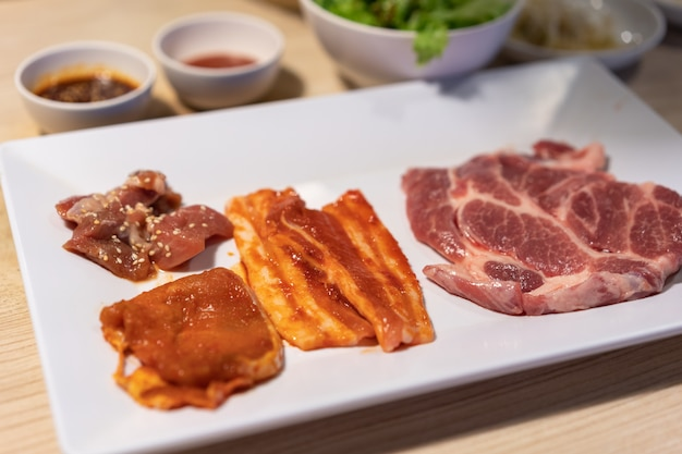 Raw pork with sauce for bbq grill