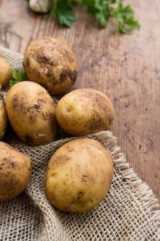 Raw potatoes on canvas sack