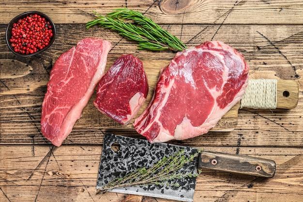 Raw prime beef steaks fillet mignon, rib eye, striploin