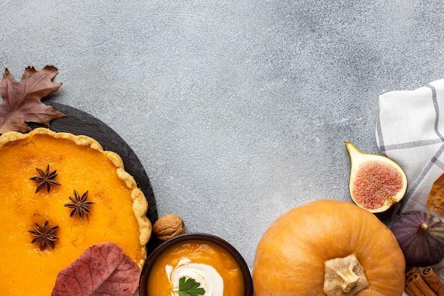 Raw pumpkin and pie copy space