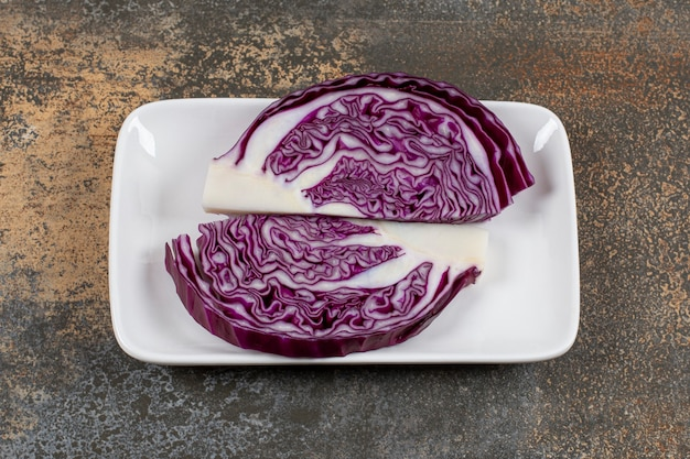 Raw purple cabbage in the bowl on the marble surface