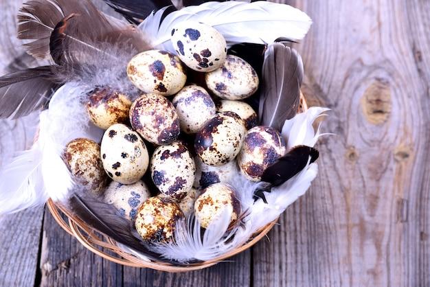Raw quail eggs in a basket