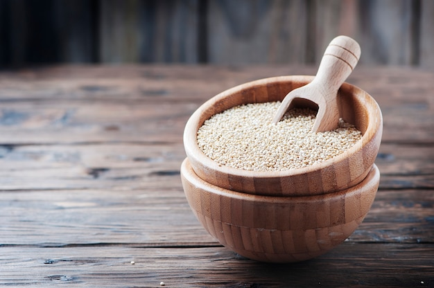 Raw quinoa on the wooden table