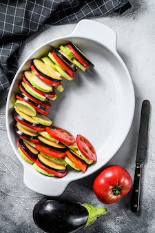 Raw ratatouille, traditional french vegetable dish. top view.