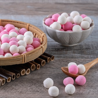 Raw red and white tangyuan glutinous rice dumpling balls. winter solstice festival food.