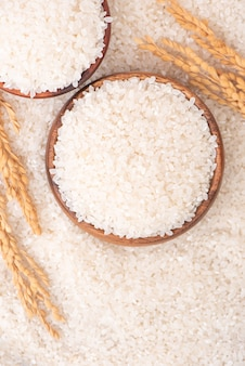 Raw rice in a bowl, top view overhead shot, close up