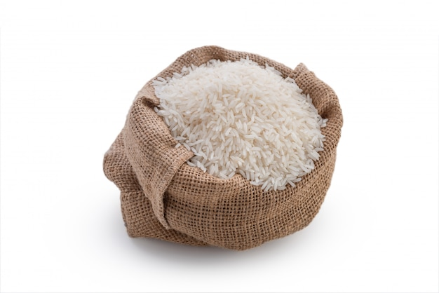 Raw rice in sack on white background