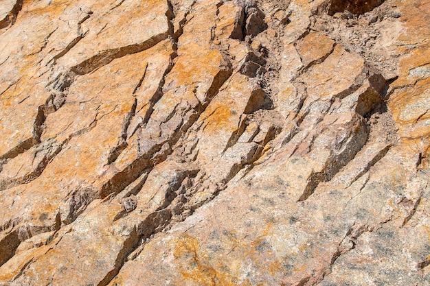 Необработанный грубый желтый золотисто-коричневый гранит текстуры фона естественный рок камень текстура фон
