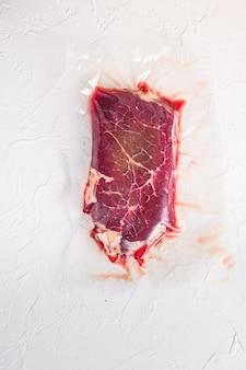 Raw rump beef steak, vacuum packed organic meat for sous vide cooking