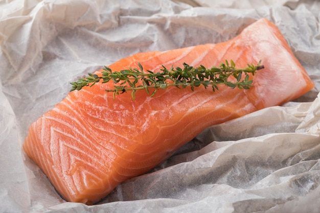 Raw salmon fillet with rosemary. closeup