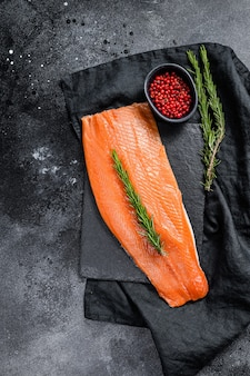Raw salmon fillet with rosemary and pink pepper. organic fish