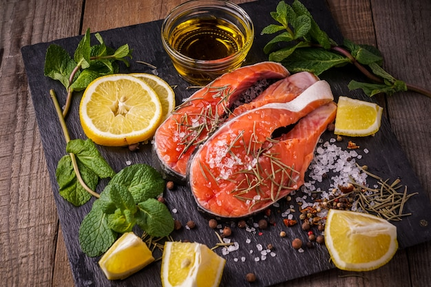 Raw salmon fish before preparing with olive oil