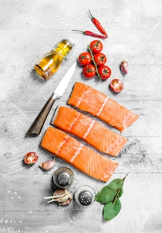 Raw salmon fish steaks with spices. on a rustic background.