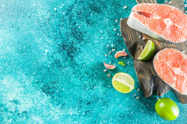Raw salmon fish steaks with spices