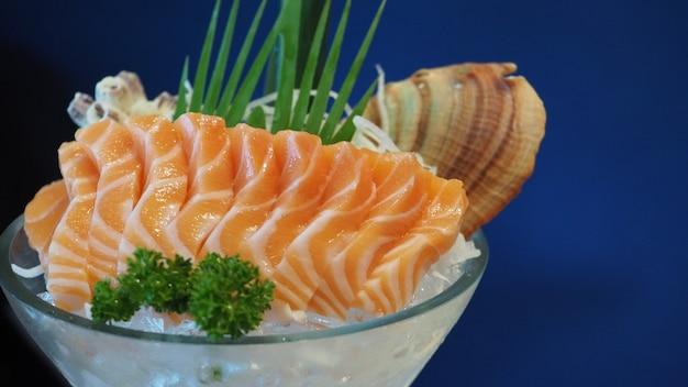 Raw salmon sashimi on black plate. it is japanese food.