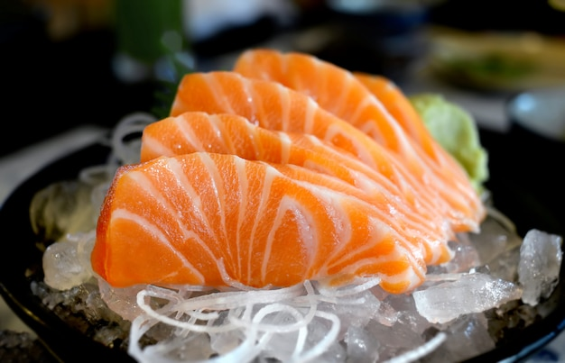 Raw salmon slice or salmon sashimi.