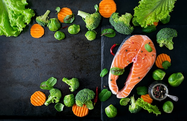 Raw salmon steak and ingredients for cooking. top view