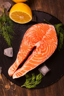 Raw salmon steak with lemon and herbs