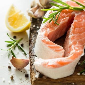 Raw salmon steaks on rustic
