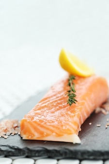 Raw salmon with pink salt and rosemary