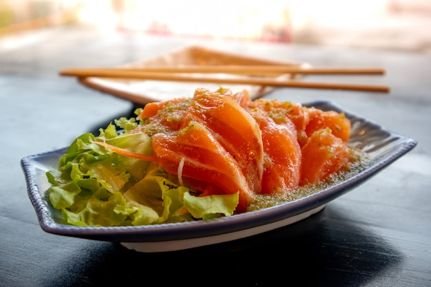 Raw salmon with spicy salad