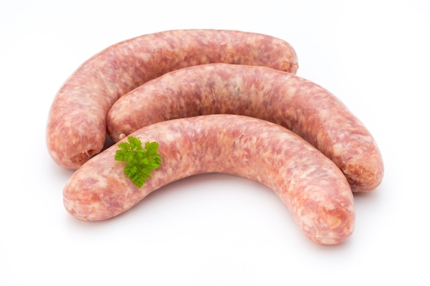 Raw sausage with parsley leaf isolated on white.