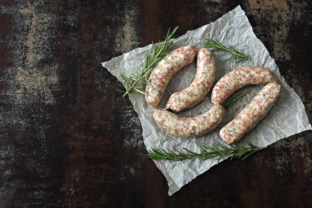 Raw sausages for grill or barbecue. juicy bavarian sausages uncooked.
