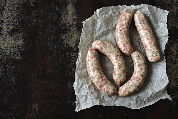 Raw sausages in paper uncooked bavarian sausages
