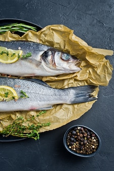 Raw sea bass with rosemary, thyme and lemon.