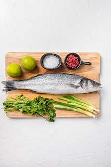 Raw sea bass with spices and herbs ingredients