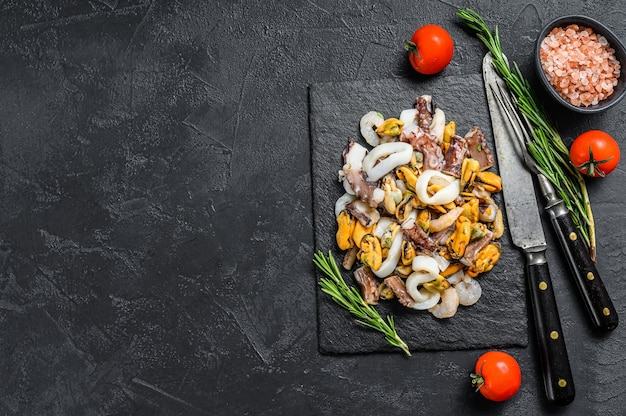 Raw seafood mix in pan top view