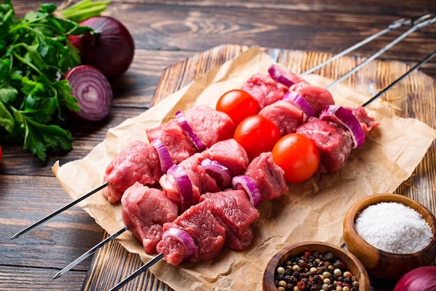 Raw shish kebab skewers  with tomatoes