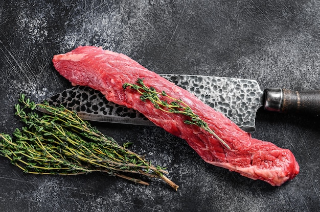 Raw skirt machete beef steak on a meat cleaver
