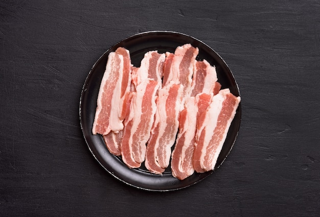 Raw sliced bacon, top view
