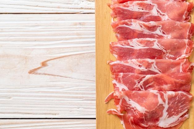 Raw sliced pork collar