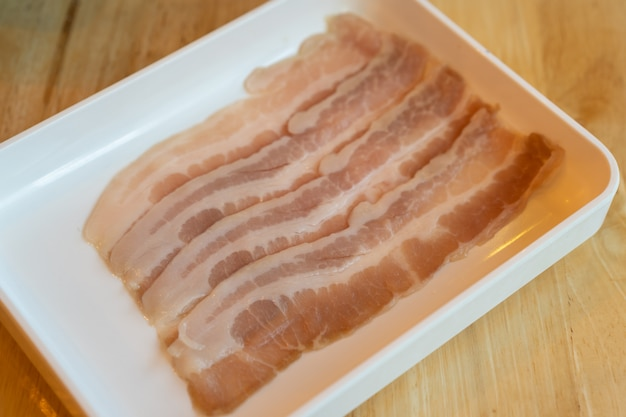 Raw sliced red pork for grilled barbecue in tray