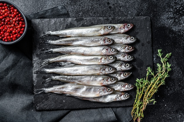 Raw small fish anchovies with pepper and thyme