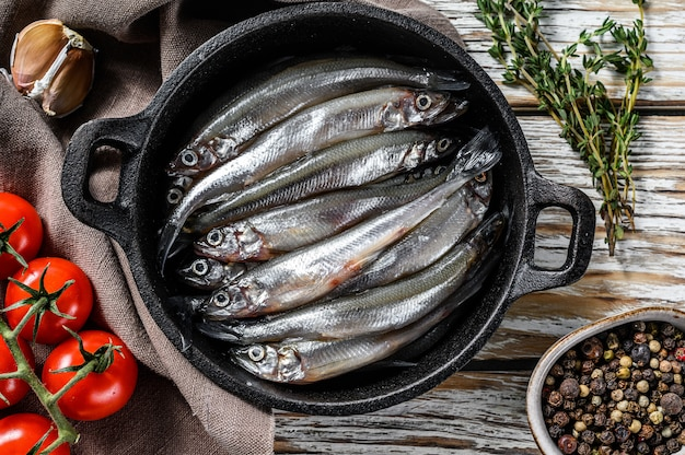 Raw small fish anchovies with pepper