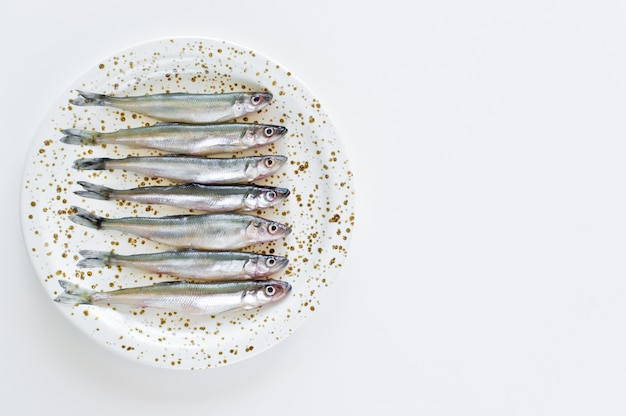 Raw smelt on a plate.