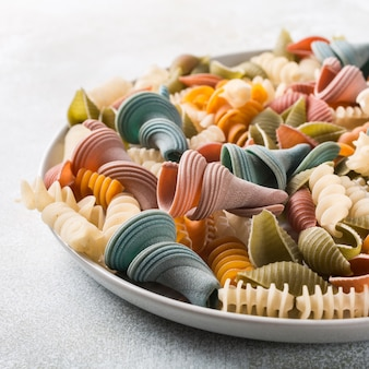 Raw spelt flour assorted colorful pasta